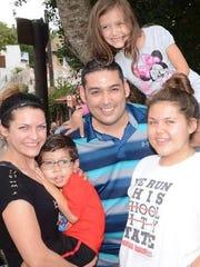 Jennifer Padilla, left, with son Victor, 4, husband