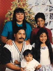 Magali Contreras, front center, as a baby with her