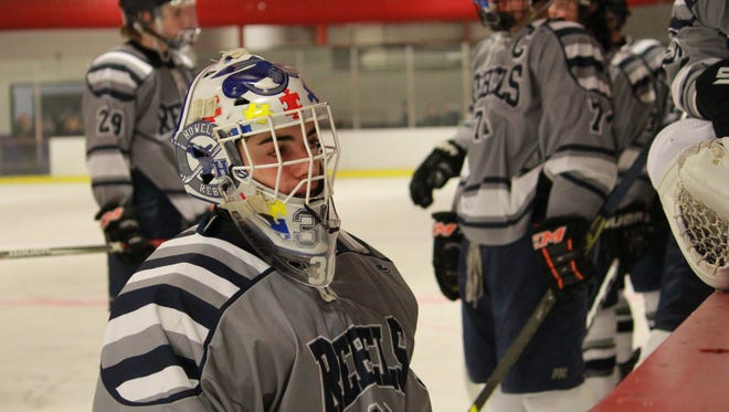 Eric McMahon of Howell wearing a mask dedicated to spreading Autism awareness.