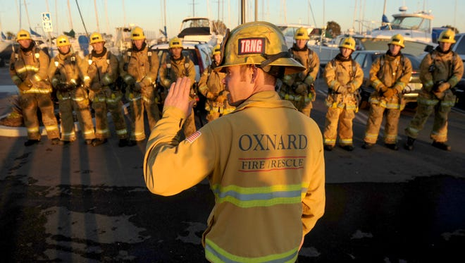 An Oxnard firefighter is seen in this 2013 photo giving instruction to fire recruits enrolled in the Oxnard Fire Department academy.