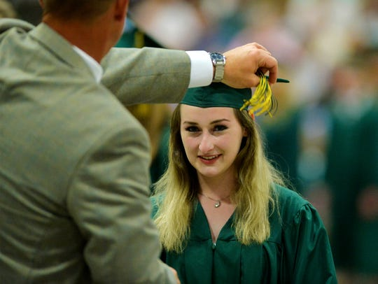 CMR principal Kerry Parsons turns over the tassels