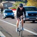 A woman bikes to work in Tempe, Ariz., on March 14, 2012.