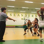John F. Kennedy Islanders senior Cianna Reyes, 44, battled her way to 10 points and nine rebounds to help her team beat the Okkodo High Bulldogs at the JFK gym on Tuesday, Nov. 24.