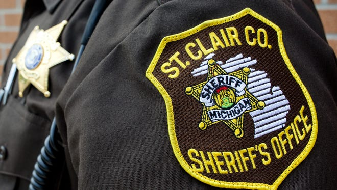 A St. Clair County deputy's badge and uniform patch.