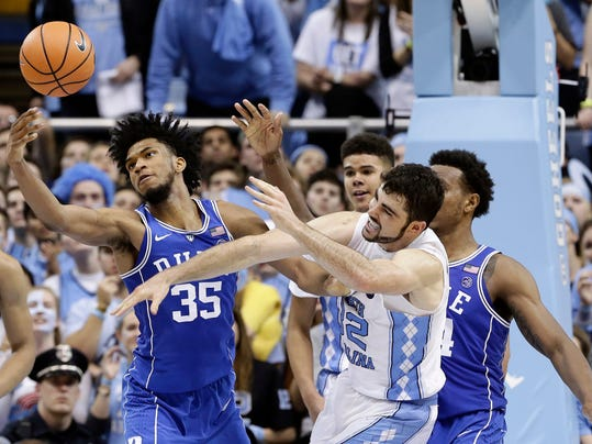 North Carolina's Luke Maye (32) and Duke's Marvin Bagley III (35) reach for a rebound during the second half of an NCAA college basketball game in Chapel Hill, N.C., Thursday, Feb. 8, 2018. (AP Photo/Gerry Broome)
