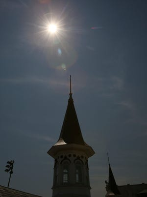 A twin spire is illuminated by the 2017 solar eclipse at Churchill Downs during peak coverage at 2:27pm.