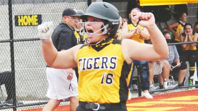 Versailles junior Maris Ollison celebrates as she crosses home plate on Tuesday, September 8, in Versailles.