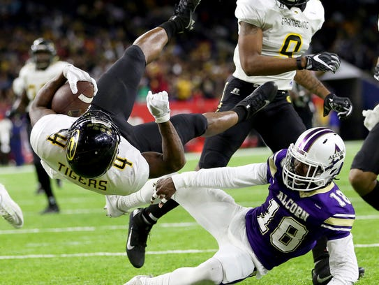 Alcorn State defensive back Leishaun Ealey (18) brings down Grambling State tailback Martez Carter (4) in the 2016 SWAC Championship game.