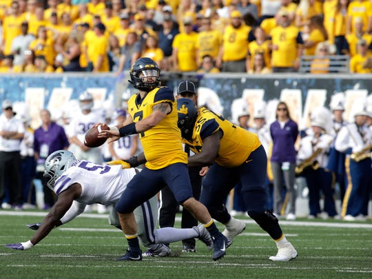 West Virginia quarterback Will Grier (7) pass the ball during the first half of an NCAA college football game against Kansas State Saturday, Sept.22, 2018, in Morgantown, W.Va. (AP Photo/Raymond Thompson)