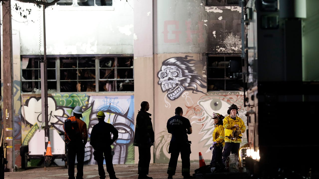 Emergency personnel stage in front of the site of a