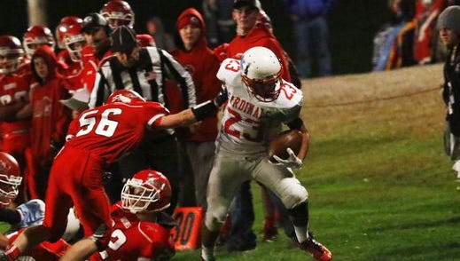 Newman Catholic's Raymond  Meyer heads downfield during the Cardinals game with Greenwood this past season.