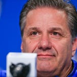 """Kentucky head coach John Calipari jokingly said to Wisconsin's Frank Kaminsky outside the interview room """"Look I'm so tired of looking at your tape right now"""" while answering media questions  with Wisconsin coach Bo Ryan at the podium Thursday at the Final Four in Indianapolis at Lucas Oil Stadium. By Matt Stone, The C-J April 2, 2015."""