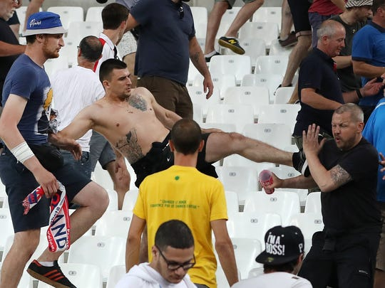 Supporters clash at the end of the Euro 2016 Group B soccer match between England and Russia, at the Velodrome stadium in Marseille, France, Saturday, June 11, 2016.  (AP Photo/Thanassis Stavrakis)