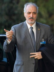 Syrian chief negotiator Bashar Ja'afari, Ambassador of the Permanent Representative Mission of Syria to UN New York, arrives for a round of negotiation between the Syrian government and the UN Special Envoy for Syria Staffan de Mistura, at the European headquarters of the United Nations in Geneva, Switzerland, Saturday, Feb. 25, 2017.