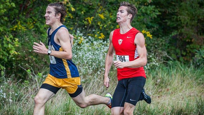 Delta's Malachi Koch and Richmond's Logan Tilton battle at the finish line during the Eagle Invitational Saturday morning.