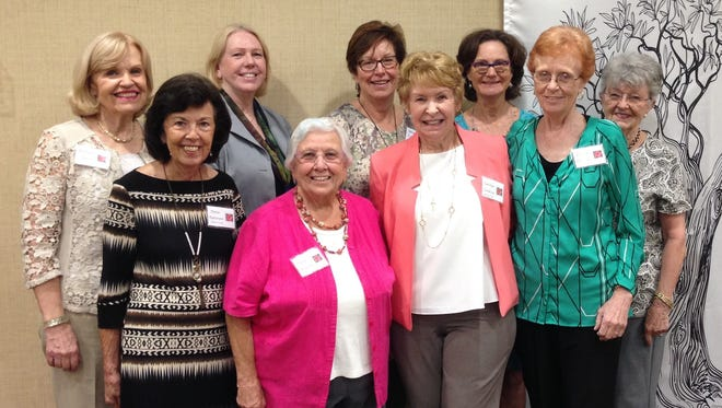Celebrations Planners enjoyed speaker Dr. Mary Carter-Waren' lecture on St. Clare of Assisi. From left, front row, are Dottie Patterson, Marie Argana, Carolyn Cordrey, and Louise Cunha. Back row, from left, Barbara Sidari, Dr. Mary Carter-Waren, Mimi Keleher, Dawn Cameron, and Sandy McDonnell.