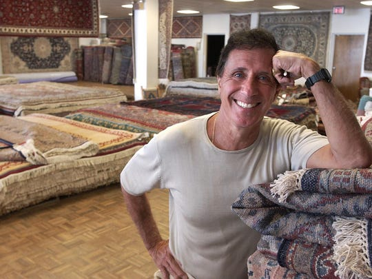 Jay Stein stands in the rug and carpet room at Stuart Kingston in Rehoboth Beach July 5, 2005. The wine collection of Stein, who died in 2014, is up for auction at Christie's in New York.