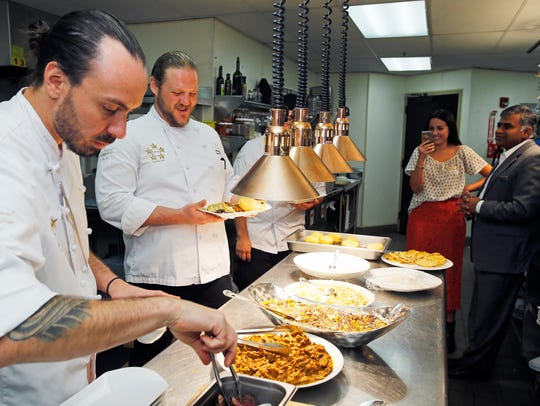Cook Domingo Spears and sous chef Jack Hupp take part