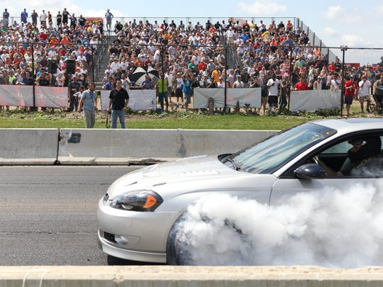 Amateur drag racers competed on a closed section of Woodward Ave during Roadkill Nights powered by Dodge in Pontiac on Friday, August 19, 2016.