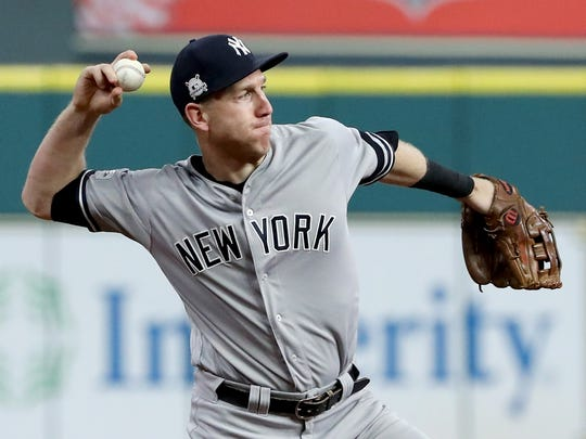 Todd Frazier of the New York Yankees fields a hit by