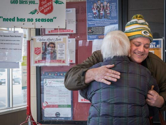 Steve Lord gets a donation and a hug from Edythe Sitte on Saturday, Dec. 23, 2017, at the Pick 'n' Save in Oshkosh. Helen Lord Burr collected donations for The Salvation Army Red Kettle drive every Christmas Eve for over 40 years. She died in September, so her family members are carrying on the tradition in the memory of all she did for the Oshkosh community.