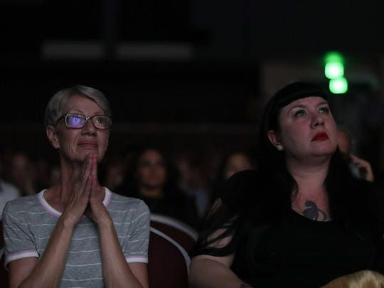 Audience members watch films at the Digicom Film Festival, Palm Springs, Calif., Thursday, May 17, 2018.