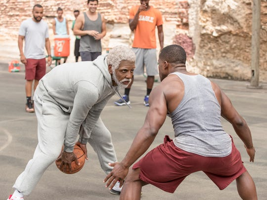 "Kyrie Irving stars as an old streetball legend who schools the new generation in ""Uncle Drew."""