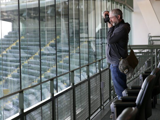 Michael Kissane, Stevenage, England, resident and member of the UK and Irish Packers fan group, takes photos during a stadium tour of Lambeau Field on Sept. 11, 2017 in Green Bay, Wis.