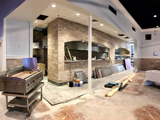 A wall separating the kitchen and the dining room has been removed to create an open kitchen format in the new Drago's Lafayette.