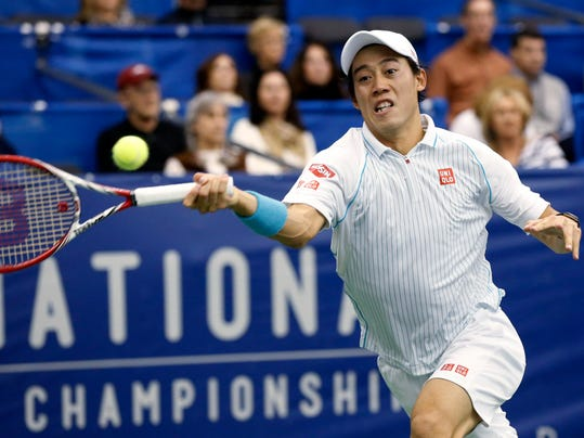 Kei Nishikori, of Japan, reaches for a return to Michael Russell, of the United States, in the semifnals at the U.S. National Indoor Tennis Championships on Saturday, Feb. 15, 2014, in Memphis, Tenn. (AP Photo/Rogelio V. Solis)