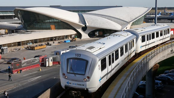In this Oct. 10, 2017 photo, an AirTrain passes the