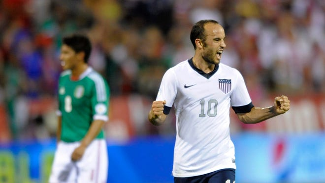 United States midfielder Landon Donovan (10) celebrates a 2-0 win over Mexico at Columbus Crew Stadium.