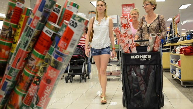 Haley Freymiller, her mother Kathy and Leigh Carmody do some after Christmas shopping at Kohl's at The Avenue Viera.
