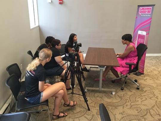 Pamela Kapolka at other PBS NewsHour workshop students interviewing Marissa Jennings, CEO of SOCIALgrlz and creator of the SOCIALgrlz app.