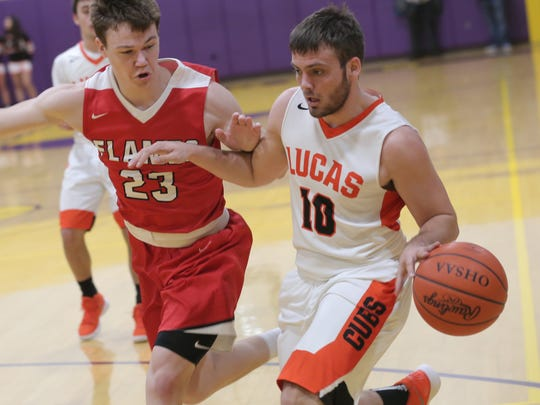 Lucas' Brian Sauder keeps the ball away from Mansfield