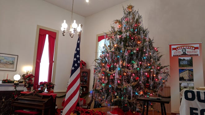 Each year, a live local tree decorated with lights, tinsel and ornaments is featured on the stage in the Lane Chapel at the Territorial Capital Museum in Lecompton.