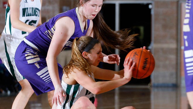 Williamston's Renee Sturm, bottom, hits the court for a loose ball against Fowlerville's Jackie Jarvis Friday, Feb. 19, 2016, in Williamston, Mich.