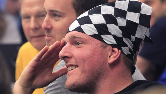 Colts player Pat McAfee, one of the celebrities participating in the Martin Plowman Celebrity Kart Race at Fast Times Indoor Kart Racing in Indianapolis on May 7, 2014.