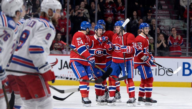 Montreal Canadiens defenseman Alexei Emelin (74) reacts with teammates after scoring a goal against the New York Rangers during the third period of Saturday's game at the Bell Centre on January 14th, 2017.