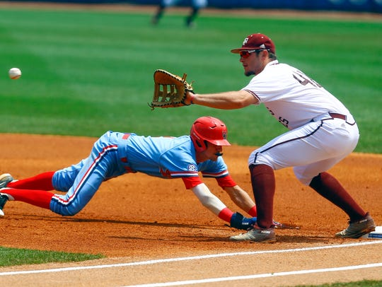 In this file photo, Ole Miss' Ryan Olenek (2) beats the throw to Texas A&M first baseman Chris Andritsos (40) as he dives back to first base during their game Saturday, May 26, 2018, in Hoover, Alabama. Olenek accounted for four of Ole Miss' seven hits in the Rebels' 12-2 route of Arkansas-Pine Bluff on Tuesday night in Oxford.