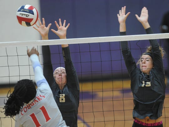 Cooper's Daniece Edwards (11) hits the ball while Clyde's