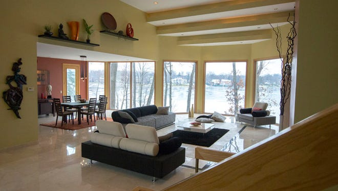 The open layout main floor of this beautiful contemporary home has a vaulted ceiling, gas fireplace, access to large back terrace, surround sound and spectacular views of Upper Long Lake.