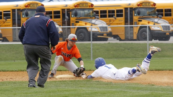 Nico Limoncelli of Horseheads is tagged out at second base by Union-Endicott shortstop Mark Ryan as he tries for a double Saturday during the Tigers' 10-3 win in Horseheads.