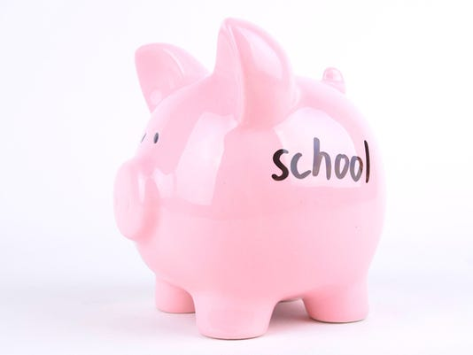 School Written on a Pink Piggybank