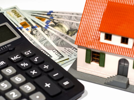 House on a calculator and money