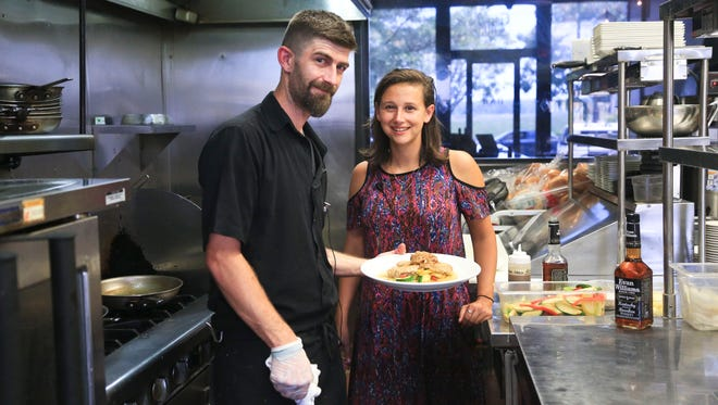 Scott Hoppel, sous chef at Gospel Bird and demo chef for 2016 Evan Williams Cooking Contest, with his Evan Williams Bourbon Chicken and Bailey Loosemore, CJ's Spirited Kitchen writer.