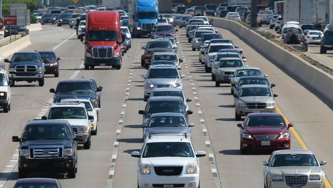 FILE - In this July 1, 2016 file photo, drivers work their way out of Dallas during rush hour. Michigan Gov. Gretchen Whitmer on Wednesday, July 8, signed a bill directing MDOT to hire a firm to conduct a study on the viability of toll roads in Michigan.