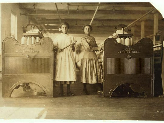 Historic photo shows mill girls Mamie and her sister Eglantine in Winchendon, Mass. Lewis Hine (1874-1940) took many photos of young mill workers.