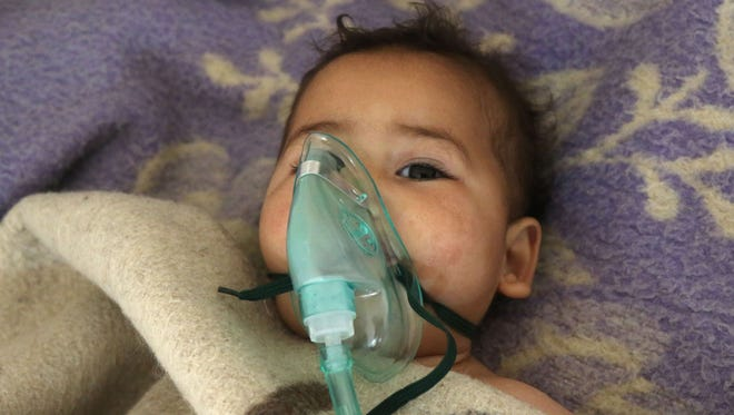 A Syrian child receives treatment at a small hospital following a suspected toxic gas attack in Khan Sheikhun, a nearby rebel-held town in Syrias northwestern Idlib province, on April 4, 2017.