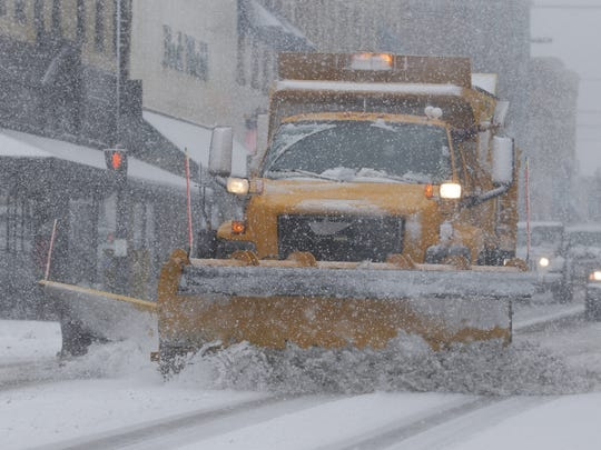 Up to 3 more inches of snow is possible in the Manitowoc area Tuesday, March 1. Pictured, a Manitowoc Public Works truck plows South Eighth Street in downtown Feb. 2.